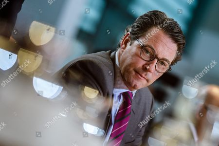 Stock Image of German Minister of Transport and Digital Infrastructure Andreas Scheuer looks on during the beginning of the weekly meeting of the German Federal cabinet at the Chancellery in Berlin, Germany, 16 October 2019. During the 71st cabinet meeting, the ministers and the Chancellor are expected to discuss, among others, a draft law concerning the modification of the air traffic taxation.