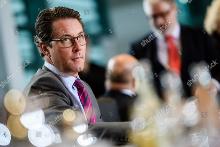 Stock Photo of German Minister of Transport and Digital Infrastructure Andreas Scheuer looks on during the beginning of the weekly meeting of the German Federal cabinet at the Chancellery in Berlin, Germany, 16 October 2019. During the 71st cabinet meeting, the ministers and the Chancellor are expected to discuss, among others, a draft law concerning the modification of the air traffic taxation.