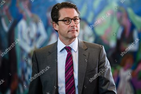 Stock Picture of German Minister of Transport and Digital Infrastructure Andreas Scheuer arrives for the beginning of the weekly meeting of the German Federal cabinet at the Chancellery in Berlin, Germany, 16 October 2019. During the 71st cabinet meeting, the ministers and the Chancellor are expected to discuss, among others, a draft law concerning the modification of the air traffic taxation.