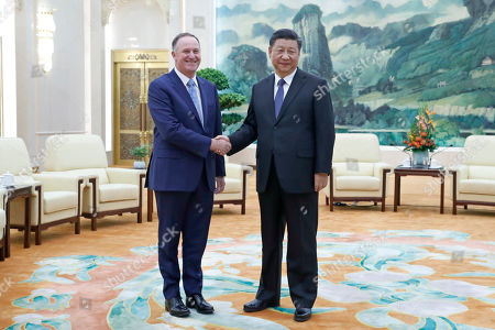 Chinese President Xi Jinping (R) shakes hands with New Zealand former prime minister John Key (L) before their meeting at the Great Hall of the People in Beijing China, 16 October 2019.