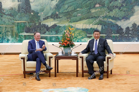 Chinese President Xi Jinping (R) and New Zealand former prime minister John Key (L) during their meeting at the Great Hall of the People in Beijing China, 16 October 2019.