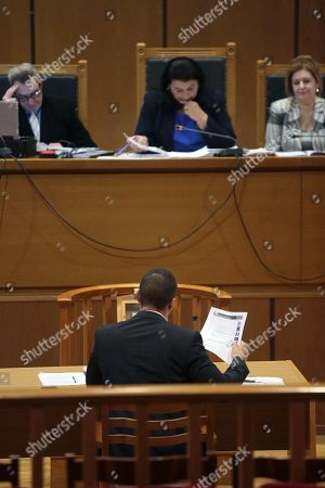 Ilias Kasidiaris (C), a former Member of Parliament (MP) of the extreme-right Golden Dawn party, testifies before a criminal appeals court in Athens, Greece, 16 October 2019. A total of 18 Golden Dawn officials who were elected in the Greek Parliament in 2012, are expected to testify in court as suspects. The trial began on 20 April 2015 and the extensive case file includes charges against party MPs of setting up a criminal organization.
