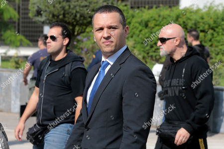 Stock Photo of Ilias Kasidiaris (C), a former Member of Parliament (MP) of the extreme-right Golden Dawn party, leaves after testifying at a criminal appeals court in Athens, Greece, 16 October 2019. A total of 18 Golden Dawn officials who were elected in Greek Parliament in 2012, are to testify in court as suspects. The trial began on 20 April 2015 and the  extensive case file includes charges against party MPs of setting up a criminal organization.