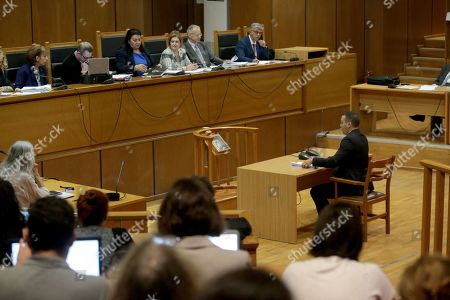 Stock Picture of Ilias Kasidiaris, a former Member of Parliament (MP) of the extreme-right Golden Dawn party, testifies before a criminal appeals court in Athens, Greece, 16 October 2019. A total of 18 Golden Dawn officials who were elected in Greek Parliament in 2012, are to testify in court as suspects. The trial began on 20 April 2015 and the  extensive case file includes charges against party MPs of setting up a criminal organization.