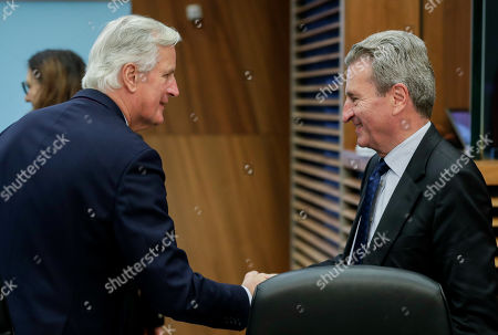 Michel Barnier (L), the EU's Chief Negotiator for the United Kingdom Exiting the European Union - dubbed Brexit -, and European Commissioner for Budget Guenther Oettinger (R) attend the weekly College of Commissioners meeting in Brussels, Belgium, 16 October 2019. Brexit talks continue in Brussels ahead of a EU summit scheduled for 17 and 18 October.