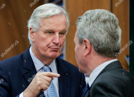 Michel Barnier (L), the EU's Chief Negotiator for the United Kingdom Exiting the European Union - dubbed Brexit -, and European Commissioner for Budget Guenther Oettinger (R) talk as they attend the weekly College of Commissioners meeting in Brussels, Belgium, 16 October 2019. Brexit talks continue in Brussels ahead of a EU summit scheduled for 17 and 18 October.