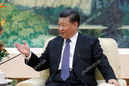 Stock Image of POOL PHOTO. China's President Xi Jinping meets with former New Zealand's Prime Minister John Key at the Great Hall of the People in Beijing
