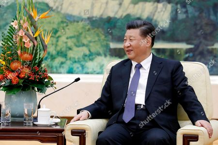 Stock Photo of POOL PHOTO. China's President Xi Jinping meets with former New Zealand's Prime Minister John Key at the Great Hall of the People in Beijing