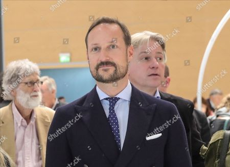Norwegian Crown Prince Haakon (C) accompanied by Juergen Boos (R), President and CEO of Frankfurter Buchmesse, arrive at the Frankfurt Book Fair 2019 in Frankfurt Main, Germany, 16 October 2019. The 71st edition of the international Frankfurt Book Fair, described as the world's most important fair for the print and digital content business, runs from 16 to 20 October and gathers authors, writers and celebrities from all over the world.