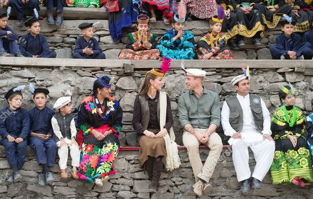 Stock Image of Prince William and Catherine Duchess of Cambridge visit a settlement of the Kalash people, to learn more about their culture and unique heritage in Chitral, Pakistan