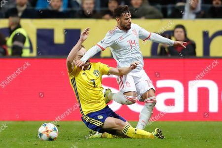 midfielder Sebastian Larsson of Sweden and defender Juan Bernat of Spain vie for the ball