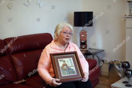 Stock Picture of In this photo dated Kate Nash holds a picture of her brother William at home in the Glendora area of Londonderry, Northern Ireland. Nash, a 70-year-old grandmother who lost her brother William in what became known as Bloody Sunday, fears, Brexit may cause the smoldering conflict in Northern Ireland to flare up once again, especially if there are renewed customs and passport controls along the border between the Republic of Ireland and the U.K.'s Northern Ireland