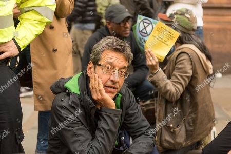 George Monbiot. Extinction Rebellion protesters block Whitehall, near Trafalgar Square