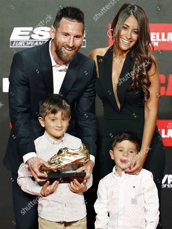 Stock Photo of FC Barcelona's Argentinian striker Lionel Messi (back L) poses for photographers with his wife Antonella Roccuzzo (back R) and two of their children after receiving his sixth Golden Shoe trophy during a ceremony in Barcelona, Spain, 16 October 2019. Messi received his sixth Golden Shoe award as top scorer in all European soccer leagues of the 2018-19 season with a total of 36 goals for FC Barcelona.