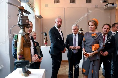 Queen Mathilde and Didier Reynders visit the 'Space Symposium of Belgium and Luxembourg', a collaborative journey addressing future space challenges, before they visit a photography exhibition on sexual violence titled 'Stand Speak Rise Up!' organized by HRH the Grand Duchess.