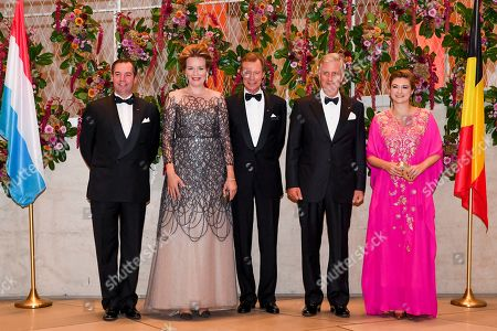Hereditary Grand Duke Guillaume of Luxembourg, Queen Mathilde, Grand Duke Henri of Luxembourg, King Philippe and Grand Duchess Stephanie of Luxembourg at a concert hosted by TTMM the King and the Queen in honour of HRH the Grand Duke followed by a reception.