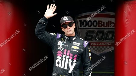 Stock Image of Monster Energy NASCAR Cup Series driver Jimmie Johnson (48) waves at driver introductions during a NASCAR Cup Series auto race at Talladega Superspeedway, in Talladega, Ala