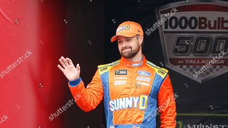 Stock Photo of Monster Energy NASCAR Cup Series driver Ricky Stenhouse Jr. (17) waves at driver introductions during a NASCAR Cup Series auto race at Talladega Superspeedway, in Talladega, Ala