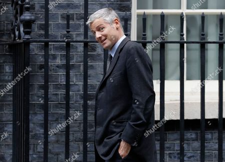 Britain's Minister of State for Environment Food and Rural Affairs and International Development Zac Goldsmith arrives for a Cabinet meeting at 10 Downing Street in London, . The European Union's chief Brexit negotiator says talks between the EU and Britain on the country's departure from the bloc are continuing after running through the night but that obstacles remain