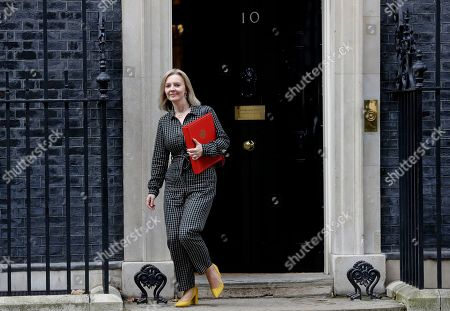 Britain's Secretary of State for International Trade Elizabeth Truss leaves after attending a Cabinet meeting at 10 Downing Street in London, . The European Union's chief Brexit negotiator says talks between the EU and Britain on the country's departure from the bloc are continuing after running through the night but that obstacles remain