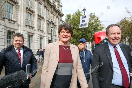 Deputy leader of the Democratic Unionist Party (DUP) Nigel Dodds (R) and leader of the Democratic Unionist Party (DUP) Arlene Foster leaves Cabinet Office