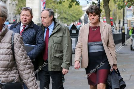 Deputy leader of the Democratic Unionist Party (DUP) Nigel Dodds (C) and leader of the Democratic Unionist Party (DUP) Arlene Foster leaves Cabinet Office