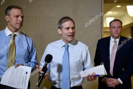 Jim Jordan, Scott Perry, Lee Zeldin. Rep. Jim Jordan, R-Ohio, center, flanked by Rep. Scott Perry, R-Pa., left, and Rep. Lee Zeldin, R-N.Y., right, talks with reporters on Capitol Hill in Washington, outside the room where people are interviewed for the impeachment inquiry