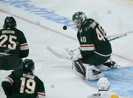 Minnesota Wild goalie Devan Dubnyk stops a shot agents the Pittsburgh Penguins during an NHL hockey game, in St. Paul, Minn