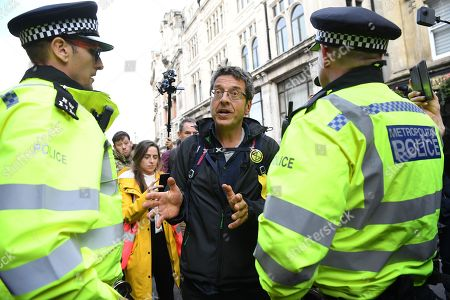 British journalist George Monbiot is arrested by police during an Extinction Rebellion protest in London, Britain, 16 October 2019. Global climate movement Extinction Rebellion announced climate change protests and blockades worldwide for two weeks starting 07 October.