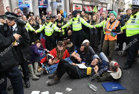 British journalist George Monbiot before being arrested by police during an Extinction Rebellion protest in London, Britain, 16 October 2019. Global climate movement Extinction Rebellion announced climate change protests and blockades worldwide for two weeks starting 07 October.
