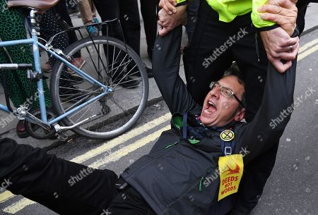 British journalist George Monbiot being arrested by police during an Extinction Rebellion protest in London, Britain, 16 October 2019. Global climate movement Extinction Rebellion announced climate change protests and blockades worldwide for two weeks starting 07 October.