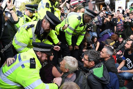 British journalist, George Monbiot sits on the road before being arrested during an Extinction Rebellion protest in London, Britain, 16 October 2019. Global climate movement Extinction Rebellion announced climate change protests and blockades worldwide for two weeks starting 07 October.