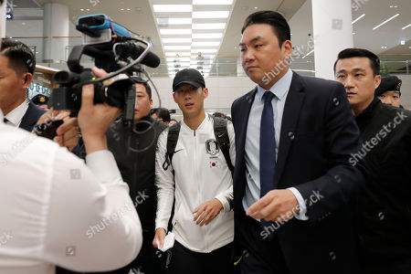 Stock Photo of South Korean national soccer team player Heung-Min Son, center, leaves at Incheon International Airport in Incheon, South Korea,. North Korea held South Korea to a 0-0 draw Tuesday in a World Cup qualifying soccer match played in an empty stadium in Pyongyang, but specific details of the game weren't immediately available. South Korean soccer officials were unable to watch a telecast of the historic game at Kim Il Sung Stadium and South Korean spectators and media were denied entry