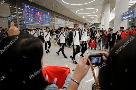 Stock Image of South Korean national soccer team's goalkeeper Jo Hyeon-woo, center, arrives with other players at Incheon International Airport in Incheon, South Korea,. North Korea held South Korea to a 0-0 draw Tuesday in a World Cup qualifying soccer match played in an empty stadium in Pyongyang, but specific details of the game weren't immediately available. South Korean soccer officials were unable to watch a telecast of the historic game at Kim Il Sung Stadium and South Korean spectators and media were denied entry