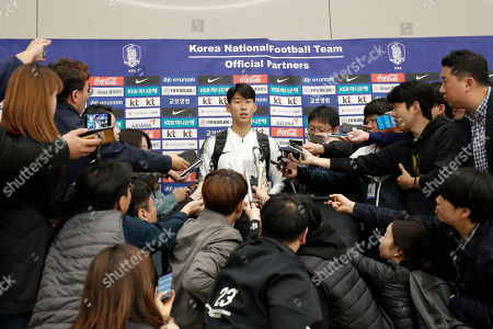 """South Korean national soccer team player Heung-Min Son answers a reporter's question upon his arrival at Incheon International Airport in Incheon, South Korea,. South Korea's national soccer team has described their World Cup qualifier against North Korea in Pyongyang as a """"rough"""" and strange match"""