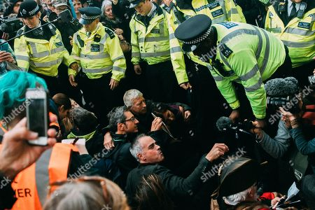 Jonathan Bartley, co-leader of The Green Party, and George Monbiot, environmental and political writer and activist, are amongst climate action protesters arrested in Trafalgar Square, London, despite a Metropolitan Police Section 14 order banning the campaign from London.