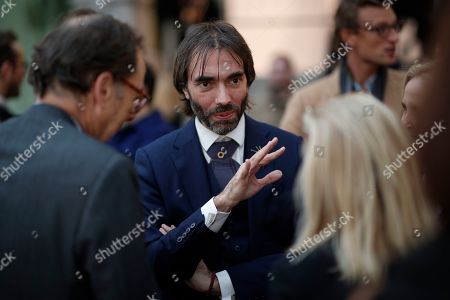 Member of French parliament and candidate to the 2020 Paris mayoral elections Cedric Villani (C) talks with visitors at the 2019 FIAC, or Foire Internationale d'Art Contemporain (International Contemporary Art Fair) at the Grand Palais in Paris, France, 16 October 2019. The fair runs from 17 to 20 October.