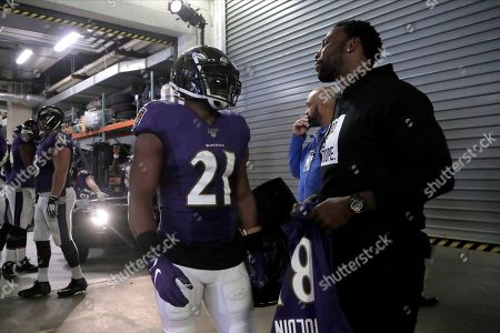 Stock Photo of Baltimore Ravens running back Mark Ingram (21) talks to former Ravens wide receiver Anquan Boldin prior to an NFL football game against the Cincinnati Bengals, in Baltimore