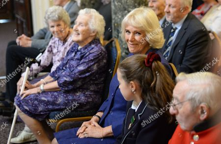Camilla Duchess of Cornwall attends a reception and tea party for the 'Poetry Together' initiative, where the young and old will recite poetry at Eaton Square Upper School.