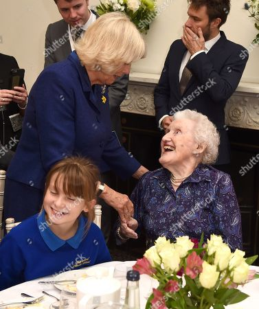 Camilla Duchess of Cornwall meets a guest as she attends a reception and tea party for the 'Poetry Together' initiative, where the young and old will recite poetry at Eaton Square Upper School.