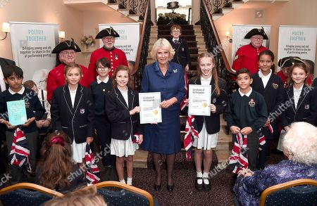 Camilla Duchess of Cornwall poses with participants as she attends a reception and tea party for the 'Poetry Together' initiative, where the young and old will recite poetry at Eaton Square Upper School.