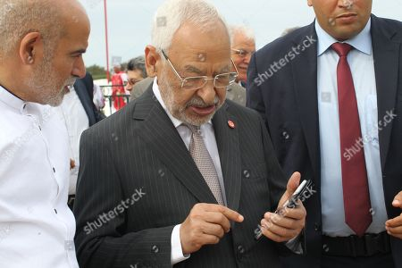Tunisian Islamist-inspired Ennahdha party leader Rached Ghannouchi (C) attends an official ceremony