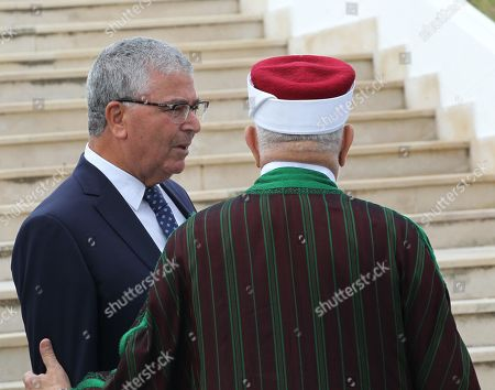 Tunisian Minister of Defence Abdelkarim Zbidi (L) and Abdelfattah Mourou Tunisia's interim parliamentary speaker and Islamist-inspired Ennahda Party politician attend an official ceremony