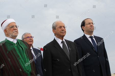 Stock Photo of (LtoR) Abdelfattah Mourou Tunisia's interim parliamentary speaker and Islamist-inspired Ennahda Party politician, Abdelkarim Zbidi minister of Defence, Mohamed Ennaceur,Tunisia's interim president and Tunisian Prime Minister Youssef Chahed attend an official ceremony