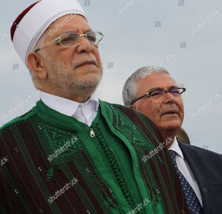 Abdelfattah Mourou Tunisia's interim parliamentary speaker and Islamist-inspired Ennahda Party politician (L) and Abdelkarim Zbidi minister of Defence, attend an official ceremony
