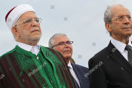 Stock Picture of (LtoR) Abdelfattah Mourou Tunisia's interim parliamentary speaker and Islamist-inspired Ennahda Party politician, Abdelkarim Zbidi minister of Defence and Mohamed Ennaceur, Tunisia's interim president, attend an official ceremony
