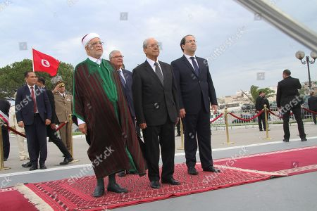 (LtoR) Abdelfattah Mourou Tunisia's interim parliamentary speaker and Islamist-inspired Ennahda Party politician, Mohamed Ennaceur, Tunisia's interim president, Abdelkarim Zbidi minister of Defence and Tunisian Prime Minister Youssef Chahed attend an official ceremony