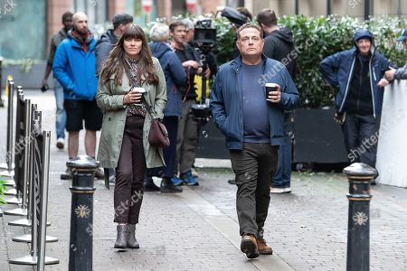 Stock Photo of John Thomson and Claire Keelan being filmed for a new series of 'Cold Feet', in and around King Street and Pall Mall in Manchester City Centre.