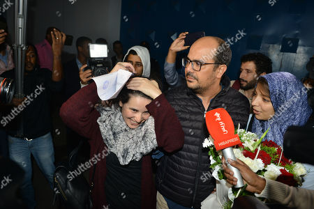 The pardoned Moroccan journalist Hajar Raissouni (C) is welcomed after her release, in Rabat, Morocco, 16 October 2019. King Mohammed VI of Morocco pardoned journalist Hajar Raissouni and all those sentenced on 30 September in connection with the journalist's alleged abortion case. Raissouni was sentenced in a Rabat court on 30 September to one year in jail for an 'illegal' abortion and sexual relations outside marriage.