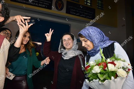 Stock Image of The pardoned Moroccan journalist Hajar Raissouni (C) is welcomed after her release, in Rabat, Morocco, 16 October 2019. King Mohammed VI of Morocco pardoned journalist Hajar Raissouni and all those sentenced on 30 September in connection with the journalist's alleged abortion case. Raissouni was sentenced in a Rabat court on 30 September to one year in jail for an 'illegal' abortion and sexual relations outside marriage.